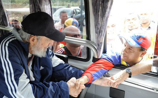 A handout picture provided on 04 April 2015 by Cuba debate shows former Cuban President Fidel Castro (L) greeting Venezuelan tourists during a visit to a school in Havana, Cuba, 30 March 2015. This was Castro's first public appearance in over a year.  EPA/CUBADEBATE / HANDOUT BEST QUALITY AVAILABLE HANDOUT EDITORIAL USE ONLY/NO SALES
