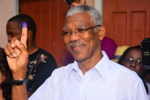 Presidential Candidate of the A Partnership for National Unity and Alliance For Change (APNU+AFC) David Granger displays his inked finger after voting at ... Photo /Guardian