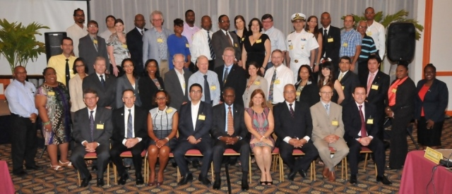 Prime Minister Hon. Marcel Gumbs (3rd seated from right front row), His Excellency Acting Governor Reynold Groeneveld (5th from left seated front row) with conference attendees on Tuesday after the official opening. DCOMM Photo