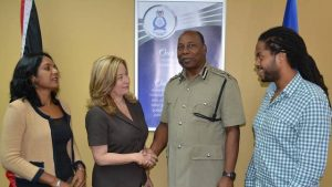 Acting Commissioner of Police Stephen Williams shares a handshake with Media Association President Francesca Hawkins after a meeting at Police Administration Building, Port-of-Spain, on June 26. Looking on are MATT Floor Member Dr. Sheila Rampersad and Secretary Jabarai Fraser. Photo courtesy T&T Police Service.