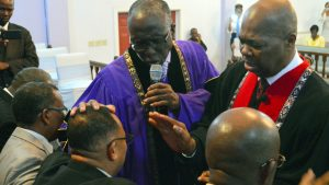 Chief Consecrator Bishop Clayton Martin (left) and Regional Overseer Bishop Michael Greenaway anoint Bishop Alfred Lafaille during the Ordination service on Saturday, July 18, 2015 (COGOP Leeward Photo)