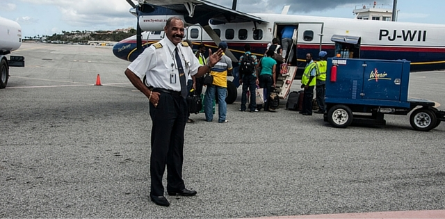 Captain R. Hodge in front of our DHC 600 Twin otter departing PJIA, St. Maarten
