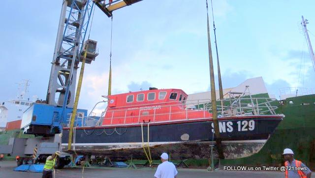 Sea Rescue Boat SNS129 being prepared to be loaded on Cargo Vessel-001