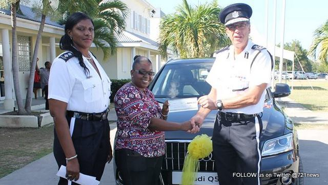 Second Place winner for RAPF Vehicle Raffle Dorian Abbott of Blowing Point accepting her cheque from Commissioner of Police Mr. Paul Morrison at PHQ on Wednesday 3rd February, 2016.