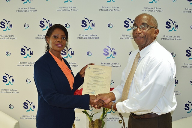 TEATT Minister Irania Arrindell presenting the Aerodrome Certificate to Deputy Managing Director of PJIA Larry Donker (right). (SXM photo)