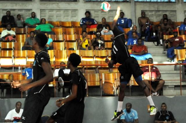 Agustin Faulkner of Saint Lucia spikes against Bermuda_ 01