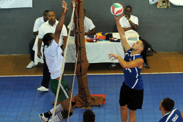 Brandon Sousa of Bermuda spikes against Dominica_ 01