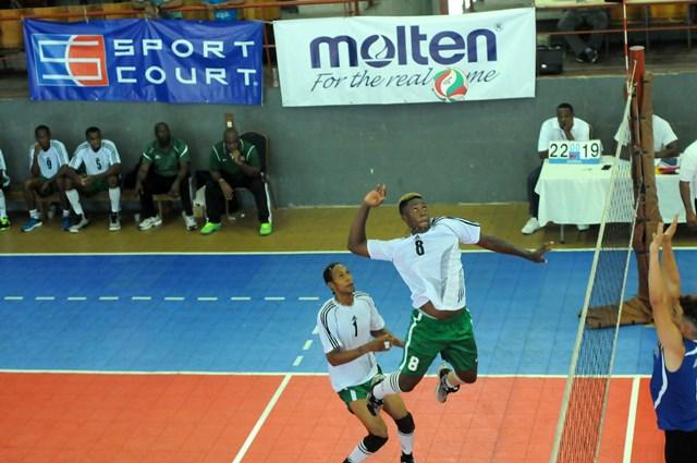 Jelani Peter of Dominica spikes against Bermuda_ 01