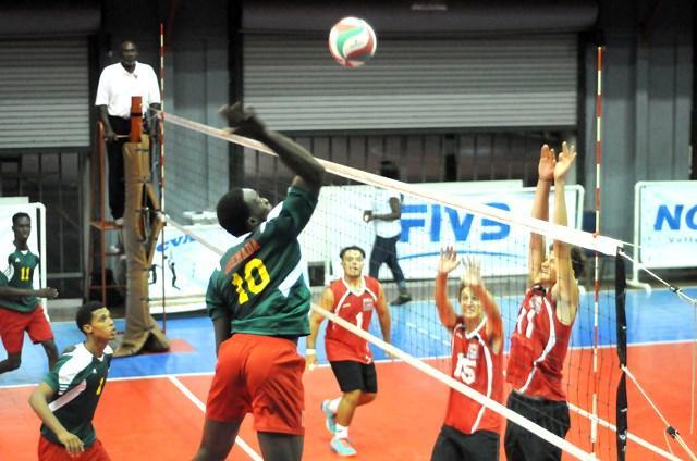 Kevon Noel of Grenada spikes against Bermuda_ 02