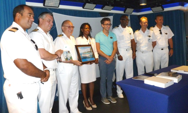 Minister TEATT: Minister Ingrid Arrindell (4th from left) after presenting a plaque to the Captain of Norwegian Escape.