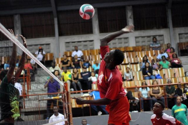 Nikel John of Grenada spikes against Dominica_ 02