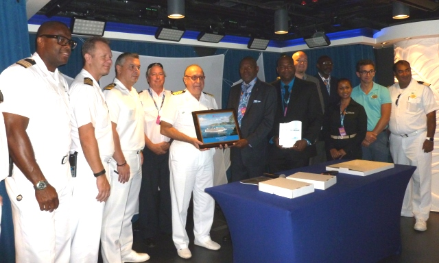 Port SXM Management: Port St. Maarten Management Team representative Hector Peters (6th from left) presenting the Captain of Norwegian Escape with a plaque.