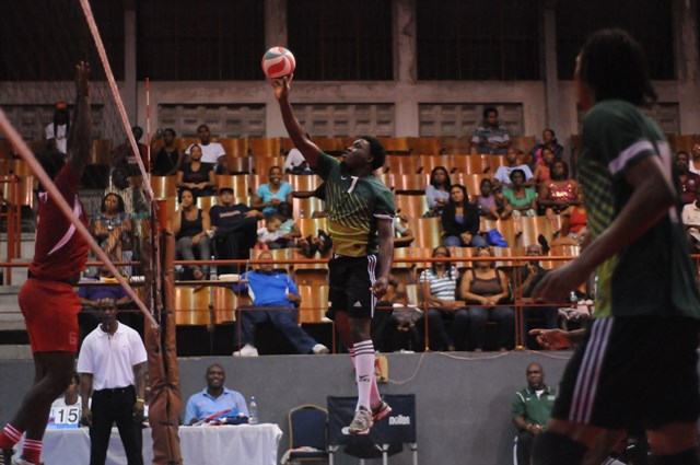 Shervan Roberts of Dominica spikes against Grenada_ 01