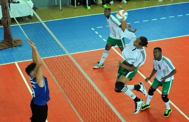 Yahn Florent of Dominica spikes against Bermuda_ 01
